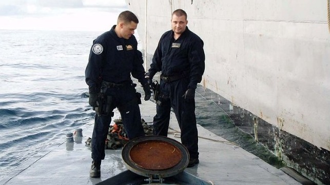 Members of LEDET 404 examine a semi-submersible drug-running craft they seized in 2008. U.S. Coast Guard photo.