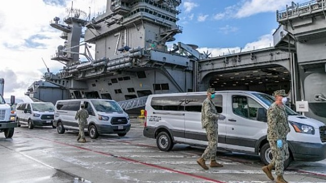 Seabees coordinate transportation of Sailors assigned to the aircraft carrier USS Theodore Roosevelt who have tested negative for COVID-19 and are asymptomatic to lodgings ashore.