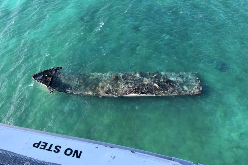 Photos: Cleanup Under Way After Yacht Burns as well as Sinks off Key West